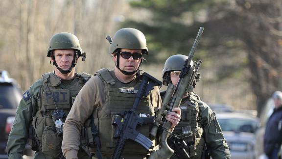 FBI SWAT team members walk along Dickinson Drive near Sandy Hook Elementary School on December 14.