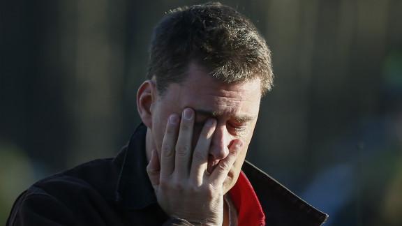 A man takes in the scene near Sandy Hook Elementary School on December 14.