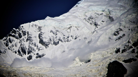 """An avalanche tumbled down the surrounding mountains of the Annapurna Base Camp in Nepal in June. After hiking for more than a week in the Himalayas, J. Grant Trammell decided to shoot some photos from the safety of base camp. """"It was a magically clear and still morning. I awoke just at 4 a.m. I made my way to a vantage point just above the Annapurna Base Camp and shot images for almost five hours."""""""