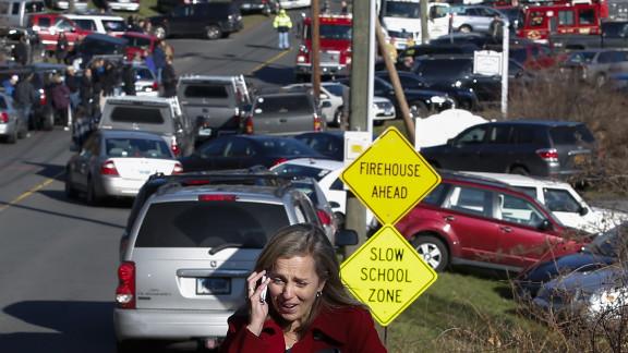 A woman weeps near Sandy Hook Elementary School on December 14.