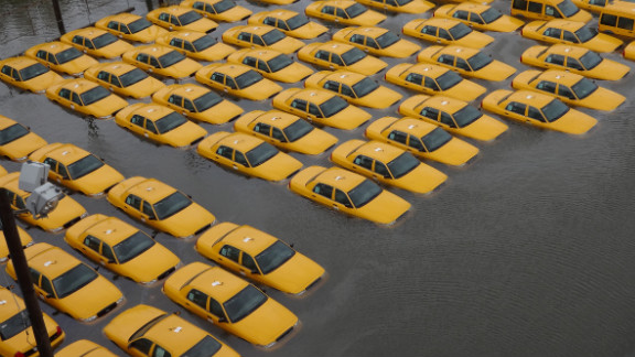 """A fleet of taxi cabs sat submerged in a flooded parking lot in Hoboken, New Jersey, after Superstorm Sandy hit the area in October. Photographer Jonathan Otto said, """"The picture was taken from the 14th street viaduct looking over the corner of Jefferson and 14th street, where it appears New York stores new cabs."""""""