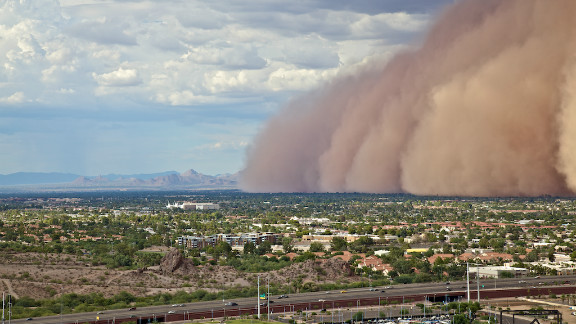 """A massive haboob, or dust storm, overtook Phoenix, Arizona in July, and Andrew Pielage knew he had to get it on camera. Racing up a mountain that was nearby, he skipped the official trail to get a better view and was able to capture it from a very unique angle. """"I had made it just in time. You really get a good and scary sense of the size and magnitude of these types of storms. It will be a photograph I will never forget."""""""