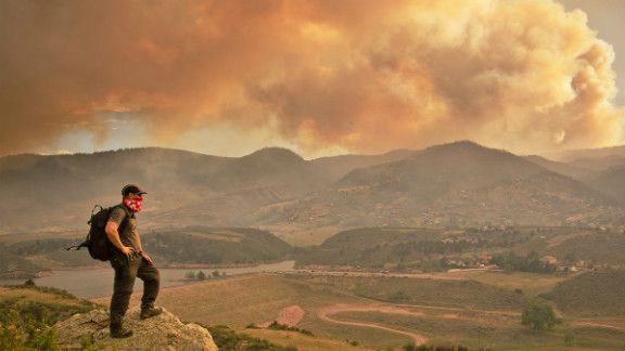 """June's High Park fire, caused by extreme drought conditions, could be seen from the Horsetooth Reservoir in Larimer County,<a href=""""http://ireport.cnn.com/docs/DOC-804593""""> Colorado.</a> """"Climbing to this vantage point afforded me the opportunity to capture the fire crew on film at eye level as they flew by, and to look down into the heliport,"""" said Bryan Maltais. """"I could also also photograph the unique atmospheric conditions that the fire created."""""""