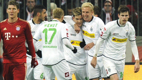 Thorben Marx celebrates his teammates after giving the visitors a 21st-minute lead, dampening the Bayern fans