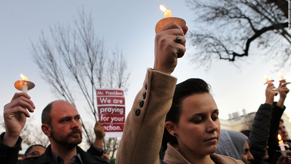Julie Henson of San Francisco joins other people outside the White House to participate in a candlelight vigil on Friday.