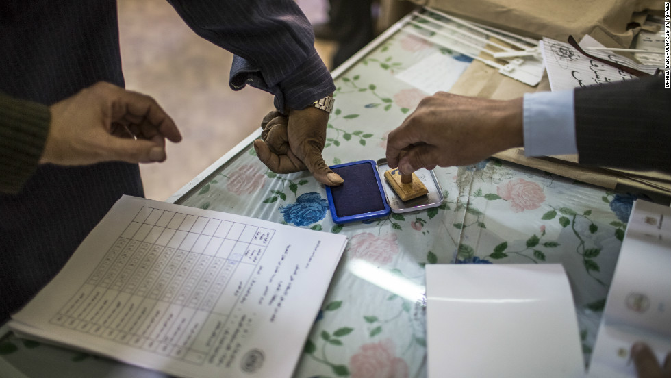 A man dips his finger on an ink pad to mark his vote in the referendum on December 15, 2012 in Cairo, Egypt.