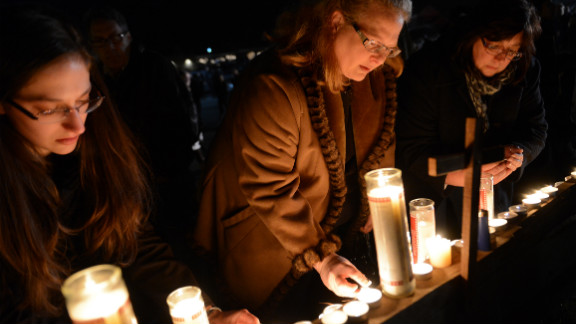 People gather for a prayer vigil at St. Rose Church in Newtown.
