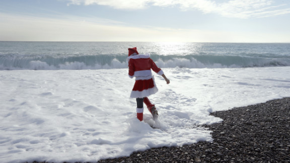 A member of a French anti-fur group wades into the sea during a beach protest to denounce the practice of wearing fur on December 15 in Nice, France.