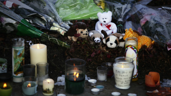 A makeshift memorial with flowers, stuffed toys and candles sit outside Saint Rose of Lima Roman Catholic Church in Newtown, Connecticut, on Saturday.