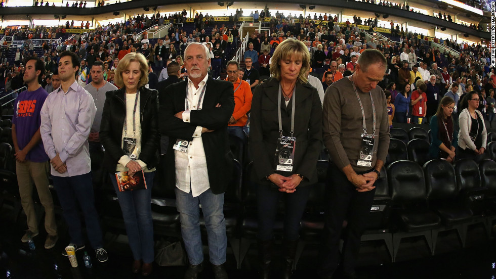 Fans at the NBA game between the Utah Jazz and the Phoenix Suns participate in a moment of silence for the victims of the Newtown shooting on Friday in Phoenix.