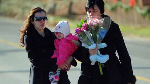 Residents arrive Saturday to pay tribute to the victims of an elementary school shooting in Newtown, Connecticut.