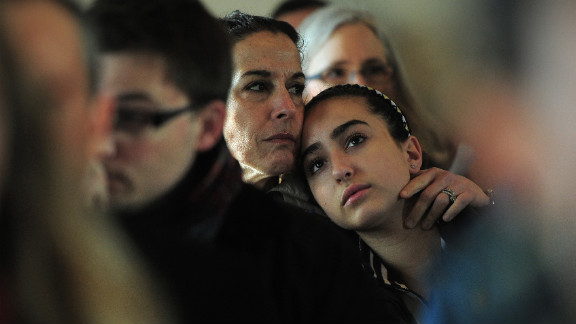 A mother and daughter attend a prayer service at St. John