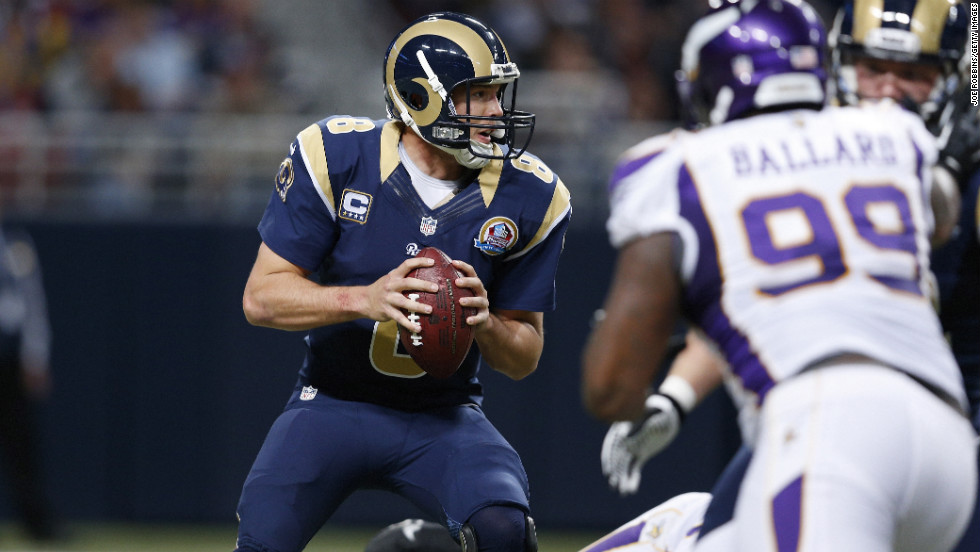 Sam Bradford of the Rams looks to pass the ball against the Vikings on Sunday.