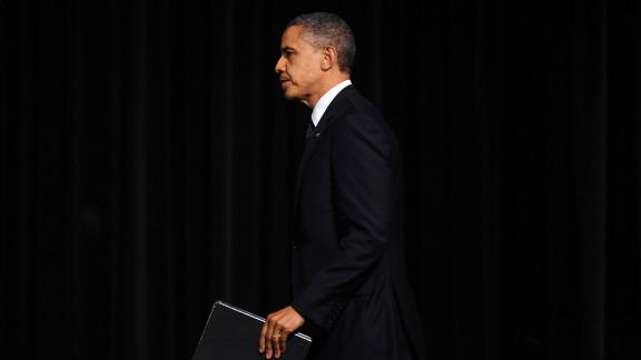 President Obama takes the Newtown High School auditorium stage for his address at the interfaith prayer vigil.