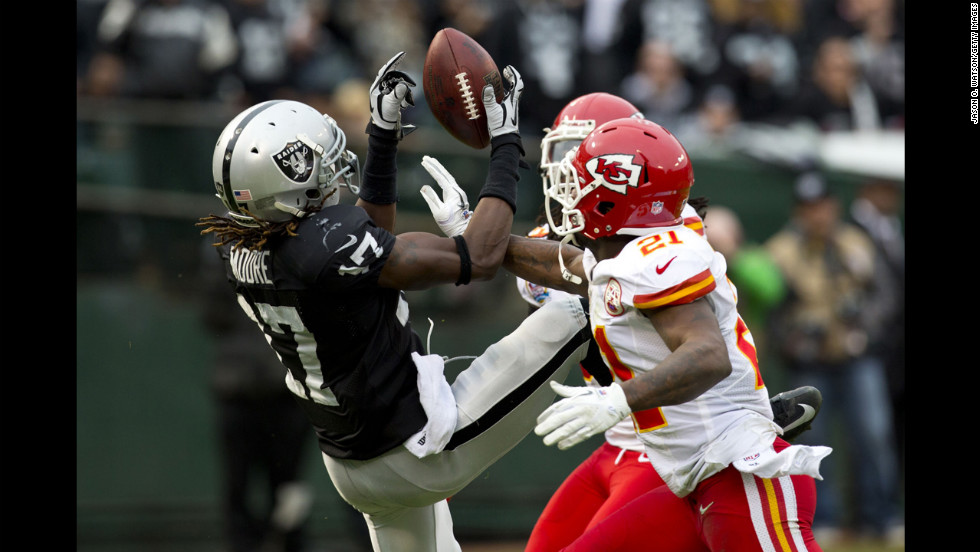 Cornerback Javier Arenas of the Chiefs breaks up a pass intended for wide receiver Denarius Moore of the Raiders during the second quarter on Sunday.