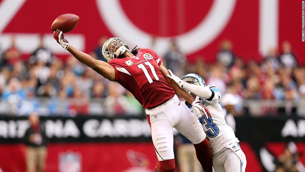 Wide receiver Larry Fitzgerald of the Cardinals is unable to make a leaping reception under pressure from cornerback Chris Houston of the Lions on Sunday.