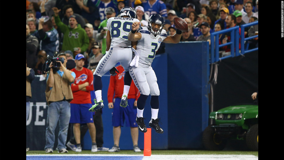 Russell Wilson of the Seahawks celebrates his rushing touchdown with teammate Doug Baldwin during the game against the Bills on Sunday.