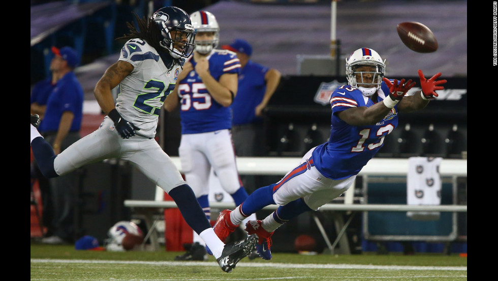 Stevie Johnson of the Bills cannot get to an overthrown pass as Richard Sherman of the Seahawks provides coverage on Sunday.