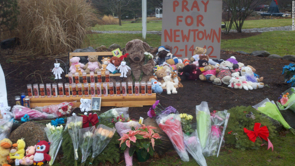 Ken Henggeler started this memorial to the victims of the shooting at the intersection of Main Street and Sugar Street in Newtown, Connecticut.