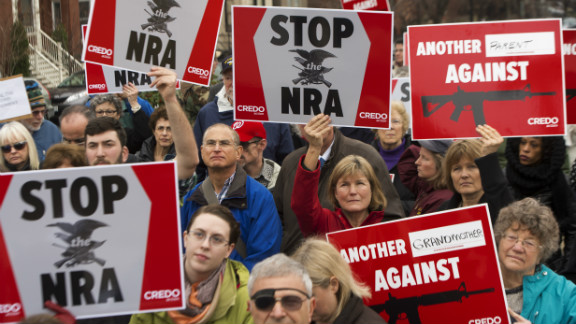 Protesters march on the National Rifle Association's Capitol Hill lobbyist offices in Washington on December 17.