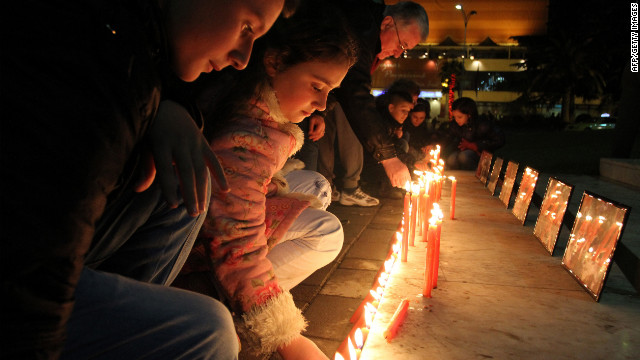 Albanian children light candles as pay their respects at Tirana's main square on December 17, 2012, to the victims of a elementary school shooting in Newtown, Connecticut.