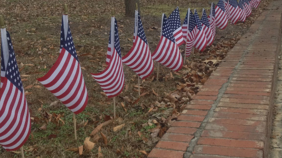 Mike Kirouac and his wife bought 27 flags they plan to place on their lawn every December 14.
