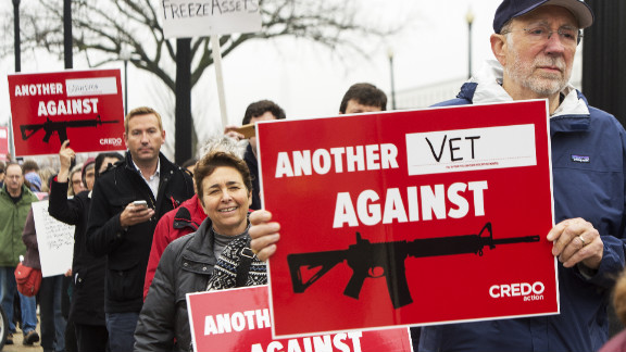 People protest the NRA  in Washington after the Newtown shootings. Pedro Noguera says we have to do more than curb guns.
