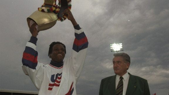 Cowbells have many different uses and are not just for skiing fans. Here American sprinter Carl Lewis of the USA is presented in 1997 with a huge cow-bell by promoter Andreas Brugger at the IAAF Weltklasse Grand Prix at the Letzigrund Stadium in Zurich, Switzerland.