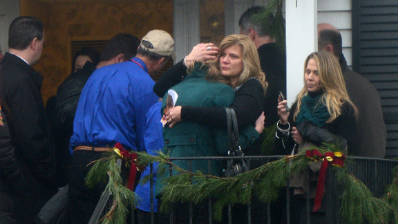 Mourners console each other after attending the funeral for Jack Pinto, 6, on December 17.