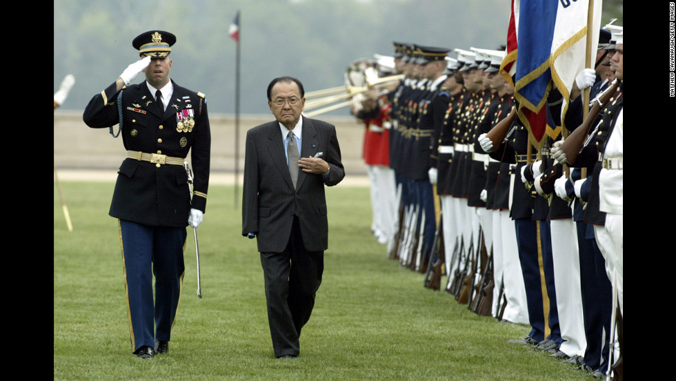 Inouye, center, is escorted by Army Gen. Charles Taylor while inspecting troops outside the Pentagon during the annual National POW/MIA Recognition Day ceremony September 14, 2004. Inouye lost an arm in World War II combat.
