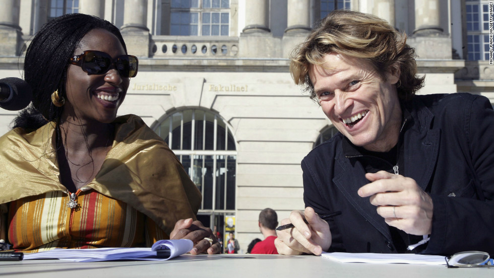 "A well-known activist, Hafsat is involved in several international initiatives. Here, she is pictured with actor Willem Dafoe in September 2006 in Berlin, Germany, during an event by the ""Dropping Knowledge"" association, a group promoting international understanding of arts and culture."