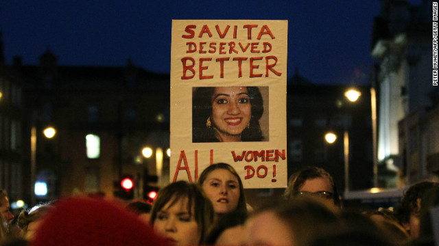 Demonstrators hold placards and candles in memory of Savita Halappanavar in support of legislative change on abortion during a march in Dublin, Ireland, in 2012.