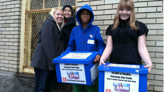 McKenna Pope (right) delivers petition signatures to Hasbro's headquarters in Pawtucket, Rhode Island, with mother Erica Boscio and brothers Gavyn and Matthew Boscio (left to right).