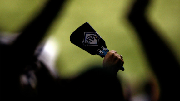 Cycling and triathlon are increasingly the domain of the cowbell. Tennis racket manufacturers gave away branded versions at the U.S. Open. Here a fan of the Tampa Bay Rays is pictured holds up a cow bell during game one of the 2008 MLB World Series against the Philadelphia Phillies.
