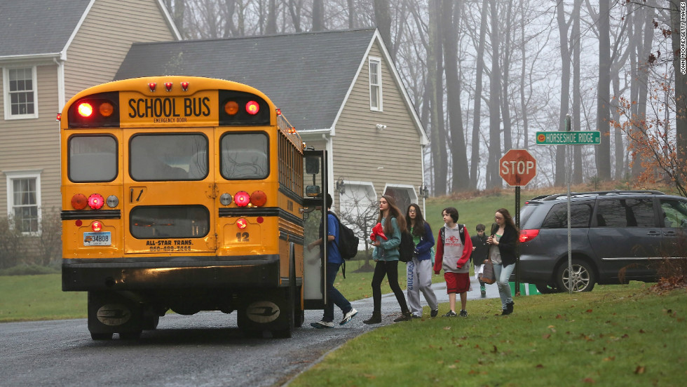 Children in Newtown, excluding Sandy Hook Elementary, return to classes on Tuesday, December 18, four days after the shooting at the elementary school.
