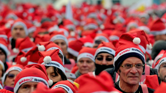 Participants wear Santa costumes as they take part in a Santa Claus-themed race in downtown Milan, Italy, on December 16.