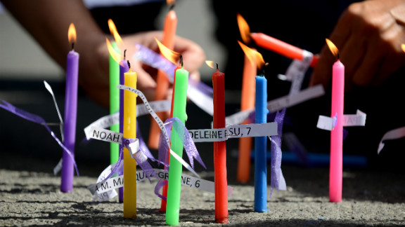 Members of the human rights group Volunteers Against Crime and Corruption light candles showing the names of those killed during the shooting at Sandy Hook Elementary School, during a prayer vigil in front of the U.S. Embassy in Manila, Philippines on December 18.