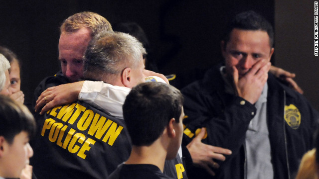 Newtown, Connecticut, first responders received an emotional standing ovation at a vigil for the school shooting victims on December 16.