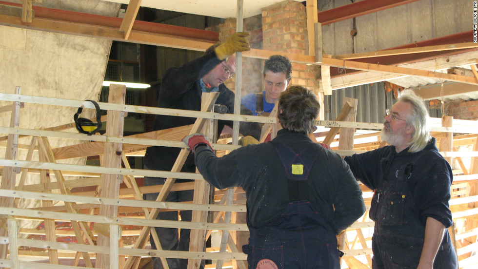 The crew are sailing in an exact replica of the original boat. Here boat-builder Nat Wilson (right) is seen  orchestrating the early stages of construction, which took two years to complete.