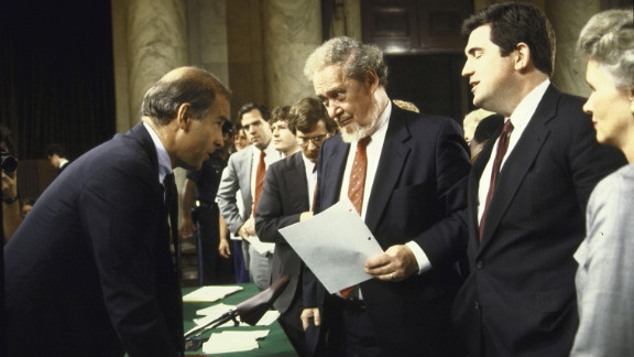 Joe Biden, left, then chairman of the Senate Judiciary Committee, chats with Bork and others after the first day of confirmation hearings.