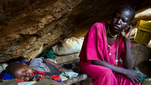 Many Nuba hide in caves to escape the bombs, says Nyange. Pictured, a mother rests with her child in a cave outside of Tess, South Kordofan, in April 2012.
