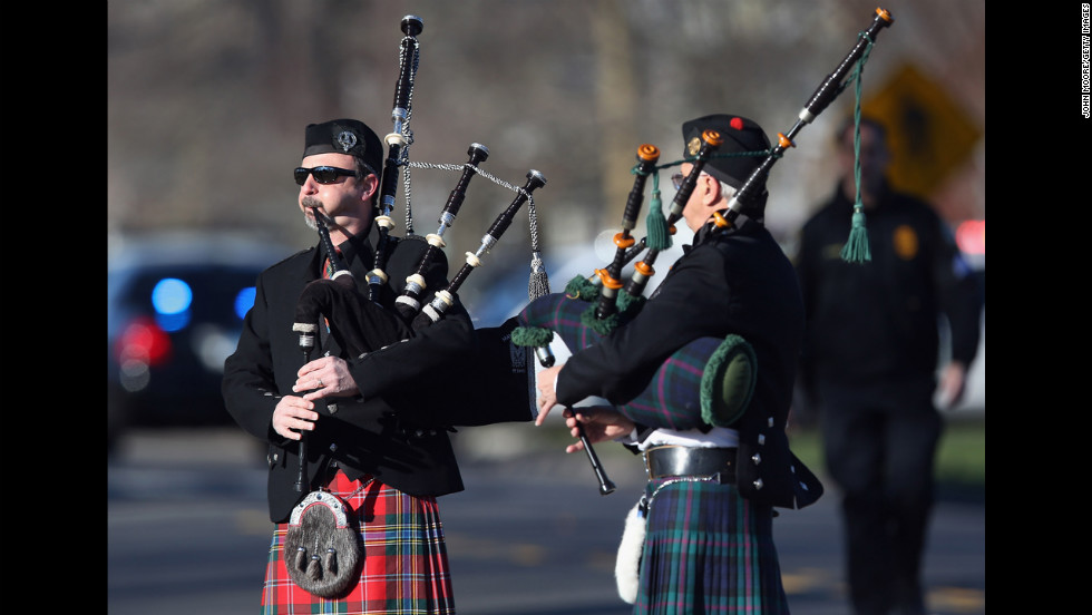Bagpipers play at funeral services for Soto on December 19 in Stratford.