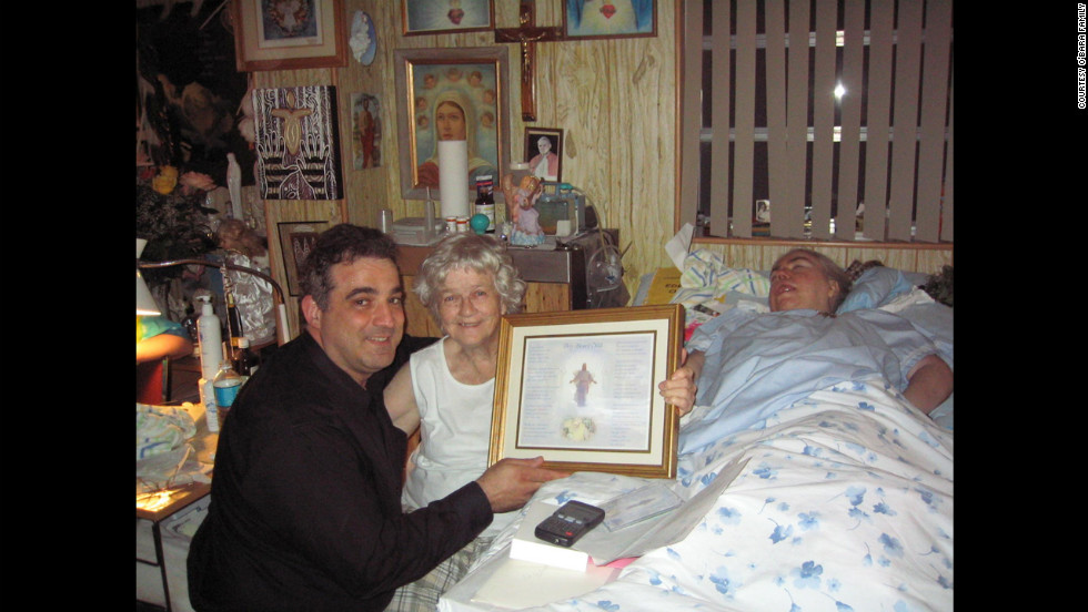 "At Edwarda's birthday party in 2006, Manny Koukoulas presents Kathryn and Edwarda with a song, ""My Blessed Child,"" that he wrote for them."