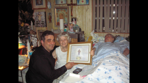 """At Edwarda's birthday party in 2006, Manny Koukoulas presents Kathryn and Edwarda with a song, """"My Blessed Child,"""" that he wrote for them."""