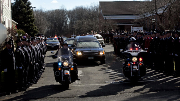 Police escort the hearse bearing the casket of Daniel Barden from St. Rose of Lima Church on December 19.