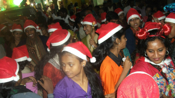 """<a href=""""http://ireport.cnn.com/people/lalith1"""">Gregory Lalith</a> took this image of festive revellers at the annual Christmas carnival in his hometown of Hyderabad, India.<br /><br />Trucks, cars and all manner vehicles are transformed into festively themed parade floats for the event, before setting off along the city's main thoroughfares and neighborhoods, he said."""