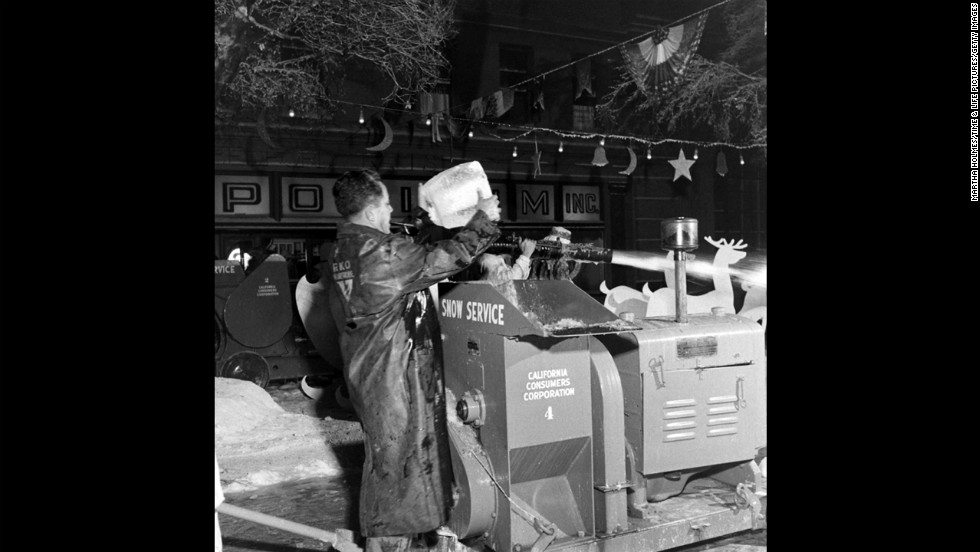 Members of the crew make artificial snow.