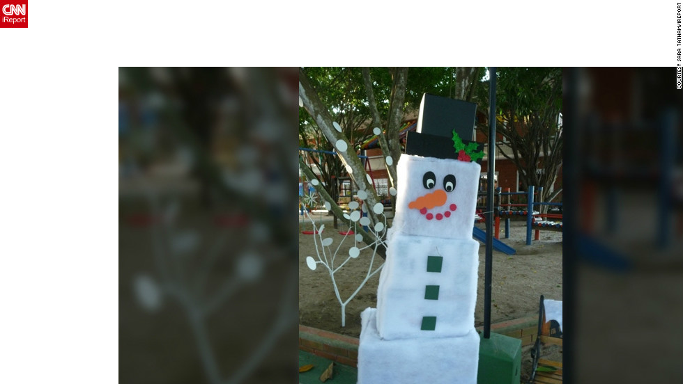 "<a href=""http://ireport.cnn.com/people/Statham"">Sarah Tatham</a> is a Canadian living in Barranquilla, Colombia. This picture of a cardboard snowman reflects her longing for home during Christmas. ""I love living in the tropics, but at this time of year I really miss seeing the lights and snow, and seeing the hustle and bustle as people buy their gifts,"" she said."