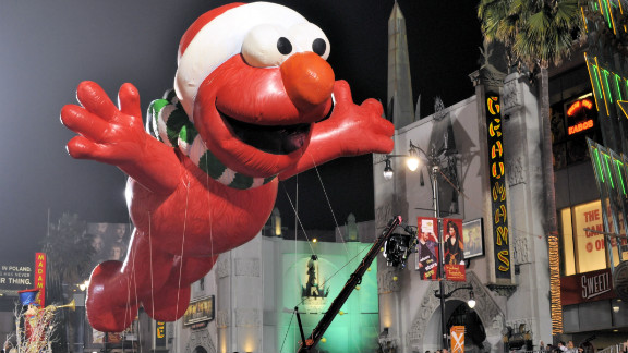 """<a href=""""http://ireport.cnn.com/people/donnaclare"""">Donna Clare</a> captured this fun shot of a giant inflatable Elmo -- of the popular children's TV show, Sesame Street -- floating high above the Hollywood Christmas Parade. """"The event, as expected was a Hollywood affair, complete with lots of red carpet and lots of celebrities,"""" she said. """"[It] felt like a movie premiere more so than a parade."""""""