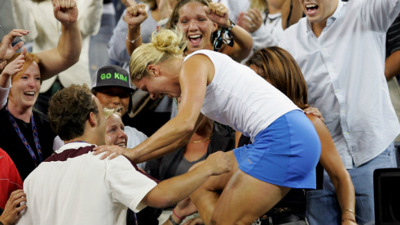 Clijsters had a love affair with New York. Here she climbs into the family area after the 2005 U.S. Open final after beating France